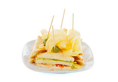 Full Club Sandwich with potato chips Stock Images