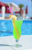 Full coctail glass by the pool Stock Photography