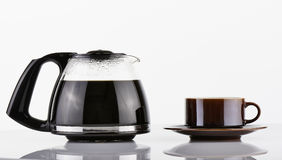 Full Coffee Pot and brown cup Stock Photography