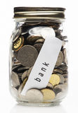 Full coins in clear bottle, saving concept Royalty Free Stock Photos
