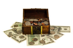 Full of coins and dollars chest isolated on white Stock Photo