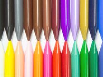 Full color crayon horizontal head to head. Arrangement Royalty Free Stock Photos