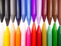 Full color crayon horizontal head to head irregular. Arrangement Stock Images
