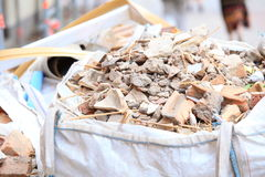 Full construction waste debris bags. Garbage bricks and material from demolished house Stock Photo