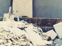 Full construction waste debris container Stock Photos