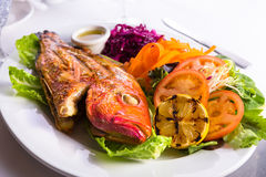 Full Cooked Tilapia Served with Vegetables and Fish Sauce Royalty Free Stock Image