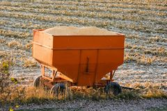 Full Corn Hopper And Fresh Snow. Full corn hopper and a fresh dusting of snow. The farmer finished harvesting just in time Royalty Free Stock Photo