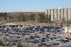 A full costco parking lot on a busy Saturday shopping day. London Ontario Canada, MArch 24 2018: A full parking lot on a Saturday in a Canadian Costco location Royalty Free Stock Image