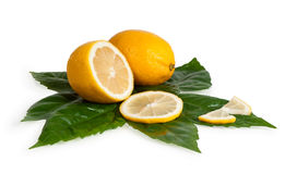 Full and cross section of yellow lemon Royalty Free Stock Photography