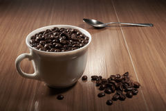 full cup of black coffee and spoon Stock Photo