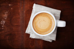 Full cup of fresh coffee on rustic wooden table Royalty Free Stock Images