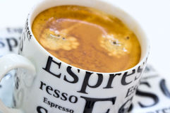 Full cup of fresh espresso coffee with crema. On white background Stock Photography