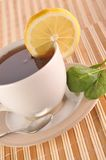 Full cup of tea with lemon Royalty Free Stock Photography