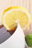 Full cup of tea with lemon Stock Images