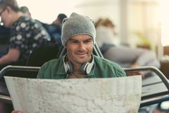 Pleasant guy is waiting for flight Stock Photos