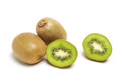 Full and cut kiwi fruits  Stock Photos