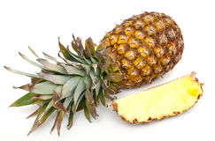 Full and cut pineapples Royalty Free Stock Images