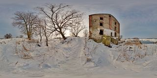 Full 360 degree panorama in equirectangular spherical projection old abandoned medieval mill in winter, VR content royalty free stock photo