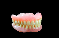 Full denture on black background Stock Photo