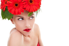 Full of desire woman. Wearing a wreath of gerbera flowers and looking to her side Stock Photos