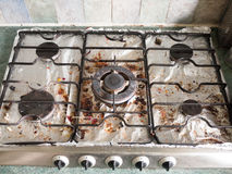 The Full Display of A Dirty Gas Metal Top Hob with Several Plate Stock Images