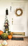 Full Door Fall Display. A Fall door adorned with a wreath and surrounded by pumpkins, pinecones and jack-o-laterns Stock Images