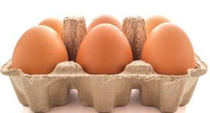 Full of eggs in paper basket. On white background Stock Photo