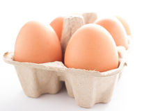 Full of eggs in paper basket. On white background Royalty Free Stock Image