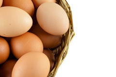 Full of Eggs put in a wicker basket in white background (isolated) Royalty Free Stock Photos
