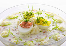 Full eggs with vegetable salad Stock Images