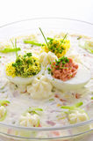Full eggs with vegetable salad Royalty Free Stock Image