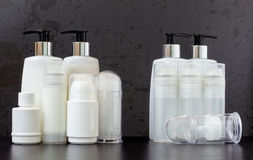 Full and Empty Beauty Product Bottles Royalty Free Stock Photography