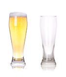 Full and empty glass of beer. On a white stock image