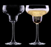 Full and empty glass of champagne Royalty Free Stock Image