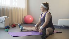 Full of energy girl with pleasure doing exercises for stretching back and legs. Stock footage stock footage