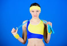 Full of energy. Health diet. Success. Sporty woman training in gym. Happy woman workout with jump rope. Strong muscles stock image