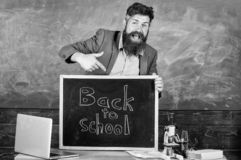 Full of energy after summer school holidays. Teacher or educator welcomes inscription back to school. Welcome back to royalty free stock photo