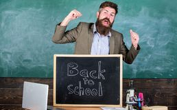 Full of energy after summer school holidays. Teacher educator welcomes new enrollees to begin study and get education. Welcome back to school. Teacher or royalty free stock images
