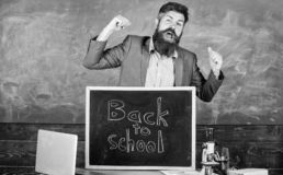 Full of energy after summer school holidays. Teacher educator welcomes new enrollees to begin study and get education. Welcome back to school. Teacher or royalty free stock photo