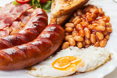 Full English breakfast with bacon, sausage, fried egg and baked beans Stock Photography
