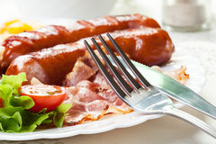 Full English breakfast with bacon, sausage, fried egg and baked Royalty Free Stock Photography