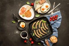 Full english breakfast on black chalkboard background stock photo