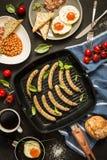 Full english breakfast on black chalkboard background Royalty Free Stock Photos
