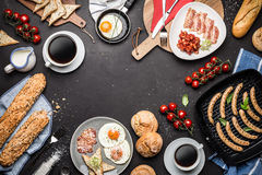 Full english breakfast on black chalkboard background. Layout with free text copy space captured from above top view, flat lay. Coffee, fried eggs, baked beans royalty free stock photos
