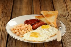 Full english breakfast with eggs, sausages, beans, toasts Stock Image