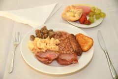 Full English breakfast with fruit and pastries Stock Images