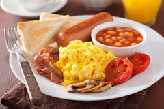 Full english breakfast with scrambled eggs, bacon, sausage, bean Stock Photography