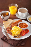 Full english breakfast with scrambled eggs, bacon, sausage, bean Stock Photo