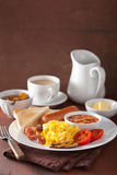Full english breakfast with scrambled eggs, bacon, sausage, bean Royalty Free Stock Image