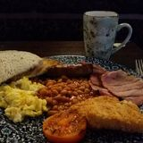 Full English Breakfast. Tasty meal with beans sausage bacon toast Stock Image